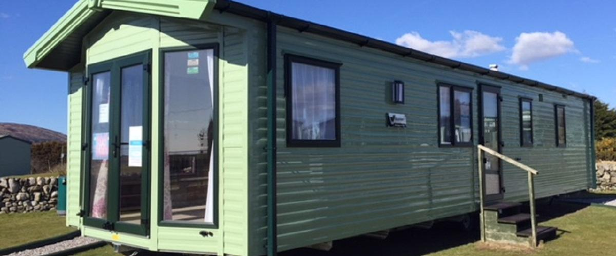 Exterior of a static caravan for sale as a holiday home at Sandgreen