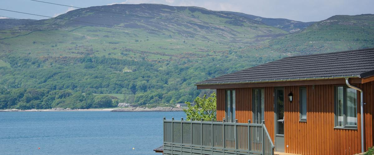 A seaside pitch for a timber lodge at Sandgreen Caravan Park